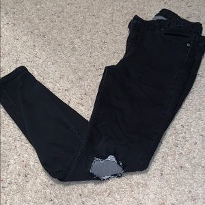 Free people ripped black jeans.